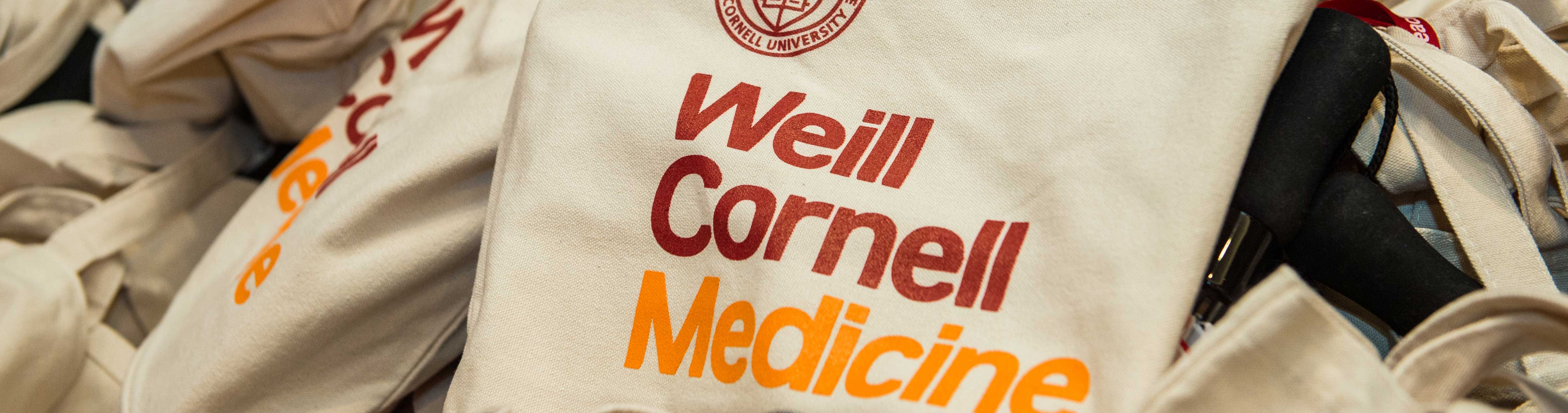 Promotional tote bags from Weill Cornell Medicine.